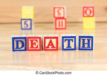 Wooden blocks with letters. Educational toy concept - children learning about death.