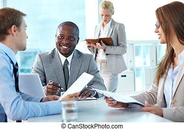 Debates - Portrait of confident boss smiling while...
