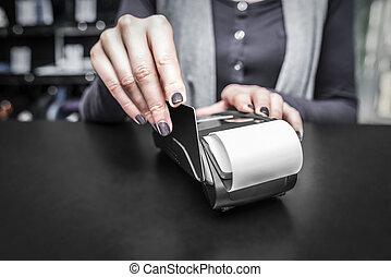 Debit card swiping on pos terminal.
