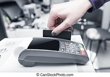 Debit card swiping on pos terminal.