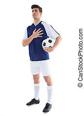 debout, boule football, bleu, joueur