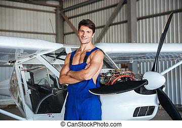 debout, bras, avion, traversé, mécanicien, petit avion, heureux