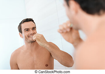 debout, brossage, salle bains, sien, matin, homme, smiles., teeth., il