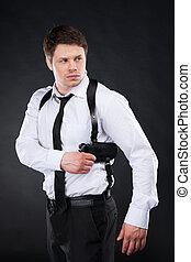 debout, chemise, loin, jeune, contre, fusil, regarder, confiant, quoique, arrière-plan noir, tenue, cravate, homme, bodyguard.