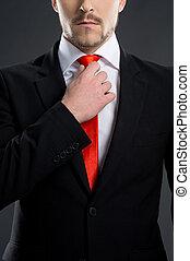 debout, cravate, ajustement, hommes, jeune, isolé, quoique, businessman., noir, autoritaire
