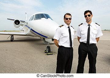debout, devant, pilotes, jet privé