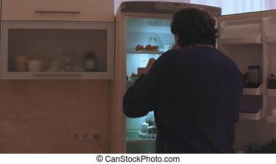 debout, devant, réfrigérateur, homme