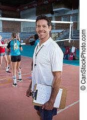 debout, entraîneur, volley-ball, sourire, tribunal