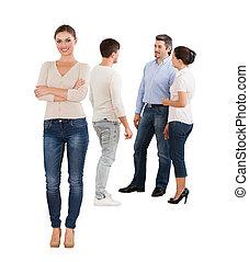 debout, femme affaires, sur, confiant, fond, équipe, blanc