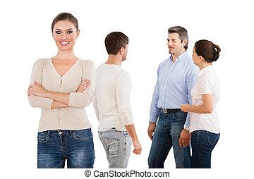 debout, femme affaires, sur, fond, équipe, blanc, heureux