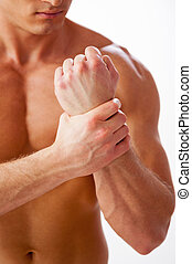 debout, gros plan, sien, douleur, jeune, musculaire, quoique, toucher, poignet, contre, fond, blanc, wrist., homme
