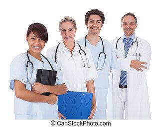 debout, groupe, sur, ensemble, médecins, blanc