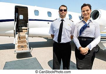 debout, jet, hôtesse, contre, privé, pilote