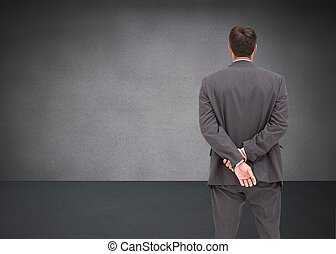 debout, mains, homme affaires, dos, derrière