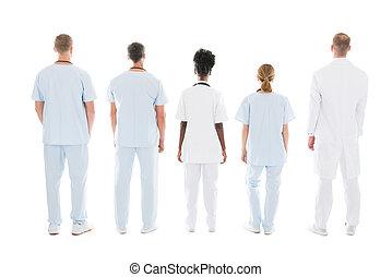 debout, monde médical, contre, fond, équipe, blanc
