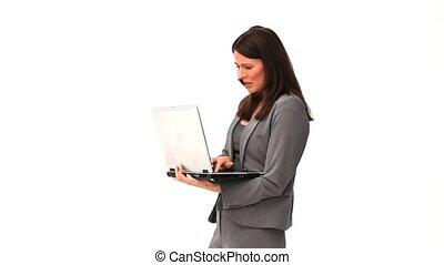 debout, ordinateur portable, affaires femme