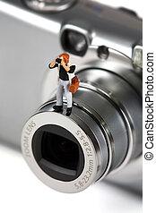 debout, photographe, lentille appareil-photo, miniature