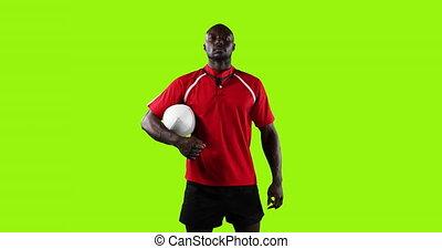 debout, rugby, arrière-plan vert, balle, tenue, joueur, professionnel, 4k