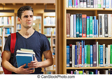 debout, tas, livres, tenue, étudiant, bibliothèque