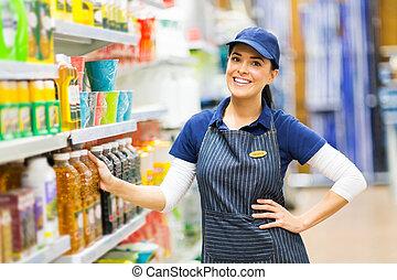 debout, vendeuse, supermarché, magasin