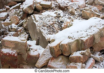 Debris of a destroyed building under the snow