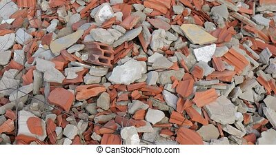 Pile of debris of a destroyed building, mostly tiles and bricks