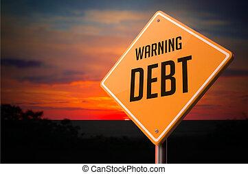 Debt on Warning Road Sign.