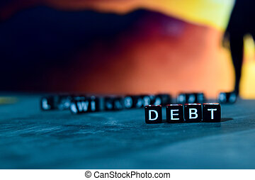 Debt on wooden blocks.