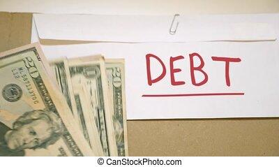 Debt payment concept - Debt pay off cash envelope