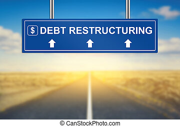 debt restructuring words on blue road sign with blurred...