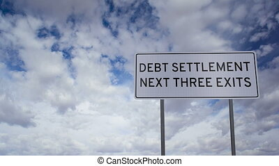 Debt Settlement Sign Clouds Timelap - Highway road sign with...