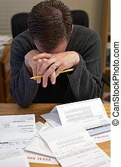 Debt - Man in despair over bills