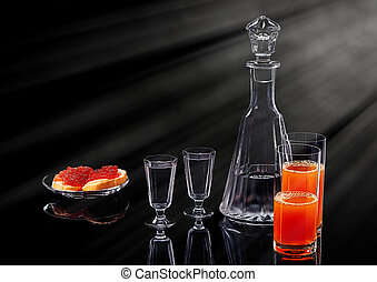 Decanter and two shot glasses with ice vodka, two salmon red...