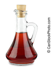 Decanter with red wine vinegar isolated on the white...