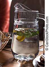 Decanter with water with lemon and mint