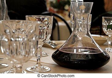 decanter with wine in a table with glass - decanter with...