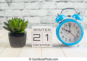 December 21 on the wooden calendar.The twenty-first day of the winter month, a calendar for the workplace. Winter