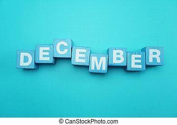 December alphabet letters on blue background