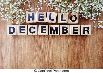 december alphabet letters on wooden background