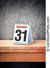December the 31st on desk calendar at office table