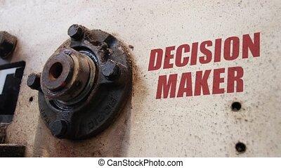 Decision maker conceptual metaphor - Machine wheels rotating...