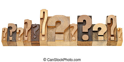 decision making concept - a row of question marks - vintage wood letterpress printing blocks