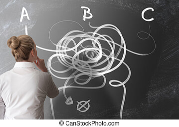 decision making concept with rear view of woman looking at chalkboard with arrows pointing in different directions