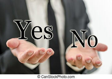 Decision making - Hand of businessman weighing word Yes and...