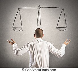 Decision of a businessman with a drawing of balance