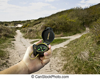 decisions, person using compass to choose the correct path