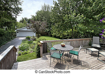 Deck and chairs leading to backyard - Deck with table and...