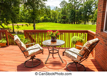 Deck - Backyard deck overlooking lake outside residential...