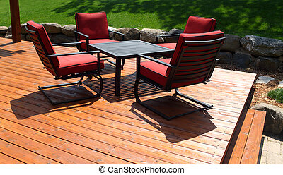 Backyard deck with furniture.