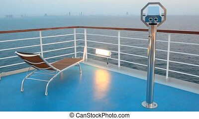 deck chair and stationary binocular on cruise ship - deck...